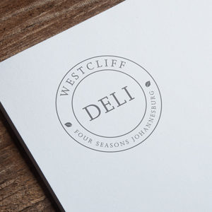 Four_Seasons_Deli_logo_mockup_small